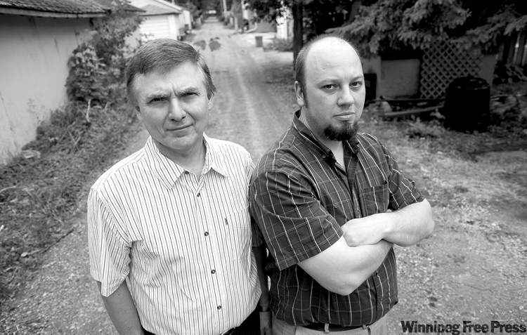 hadas parush / winnipeg free pressGreg Rudolph (left) and Neil Selluski, who with their Sunset Boulevard neighbours are paying $360,000 to pave their back lane,  call the Tory promise to pave all of Winnipeg�s 380 gravel back lanes �a little salt in the wound.�