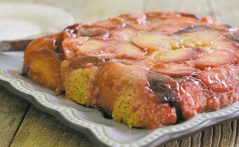 Plum upside-down cake can be elegant when you use a not-too-sweet batter made tender with olive oil and yogurt.