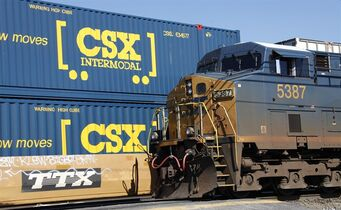 A CSX train rolls along the tracks passing another CSX train in Buffalo, N.Y. on Oct. 7, 2010. THE CANADIAN PRESS/AP, David Duprey