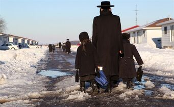Members of the Lev Tahor ultra-orthodox Jewish community walk children home from school classes in Chatham, Ont., Feb. 3, 2014. An Ontario judge has