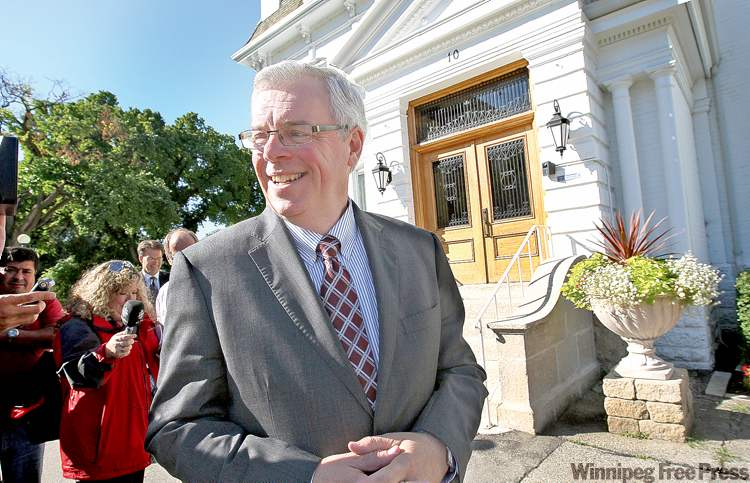 Premier Greg Selinger emerges from Government House Tuesday after the dissolution of the Manitoba legislature and official start to the election campaign.