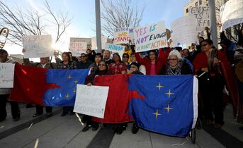 Pimicikamak First Nation members demonstrate outside Manitoba Hydro's headquarters Thursday.