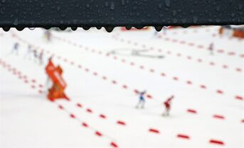 Rain drops hang on a metal bar during the Nordic combined individual Gundersen large hill competition at the 2014 Winter Olympics, Tuesday, Feb. 18, 2014, in Krasnaya Polyana, Russia. (AP Photo/Dmitry Lovetsky)