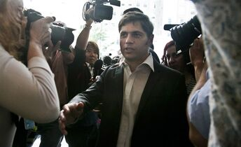 Axel Kicillof, Argentina's economy minister, arrives amid a crowd of reporters for negotiations, Wednesday July 30, 2014, in New York. THE CANADIAN PRESS/AP, Bebeto Matthews