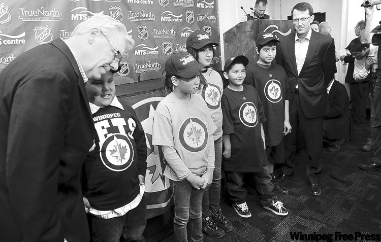 Premier Greg Selinger (left) and the Jets' Mark Chipman attend announcement at the MTS Centre.