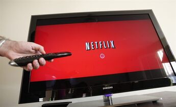 FILE - In this July 20, 2010 file photo, a person uses Netflix in Palo Alto, Calif. Netflix is tapping into six new markets on Monday hoping to gain hundred thousand new subscribers and balance out the billions spent on entertainment content each year. Their presence is welcome in most European countries, but in France Netflix is facing government-imposed regulatory hurdles and pressure from established local competitors. (AP Photo/Paul Sakuma, File)