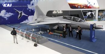 In this Oct. 28, 2013, photo, a South Korea's FA-50 fighter jet manufactured by the Korea Aerospace Industries (KAI) is displayed during a media day of Seoul International Aerospace and Defense Exhibition in Goyang, South Korea. South Korea says it has chosen the KAI, a state-run aircraft maker, as the sole preferred bidder for a contract to develop a mid-level fighter jet for about $7.8 billion with the help of Lockheed Martin Corp. (AP Photo/Ahn Young-joon)