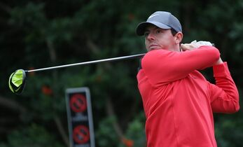 Rory McIlroy of Northern Ireland watches his tee shot during the first round of the Australian Open golf championship in Sydney, Australia Thursday, Nov. 27, 2014. McIlroy shot a 2-under 69. (AP Photo/Rick Rycroft)