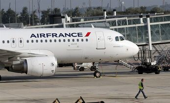 An Air France plane is parked on the tarmac at Paris Charles de Gaulle Airport in Roissy, near Paris, Monday, Sept. 15, 2014. THE CANADIAN PRESS/AP, Christophe Ena