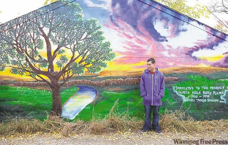 Handout photoCree artist Jesse Gouchey creates a mural at the scene of a murder in the moving short Spirit of the Bluebird.