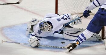 Toronto Maple Leafs goalie James Reimer makes a save during the second period of an NHL hockey game against the Chicago Blackhawks in Chicago, Sunday, Dec. 21, 2014. (AP Photo/Paul Beaty)