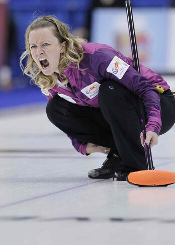 Skip Chelsea Carey yells to her sweepers in the women's 3rd place tie-breaker against Sherry Middaugh at the 2013 Roar Of The Rings championship in Winnipeg, Friday, December 6, 2013. Middaugh defeated Carey 6-3 to move onto the semi-finals. THE CANADIAN PRESS/John Woods