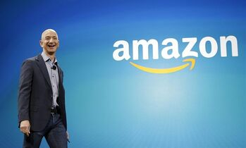 FILE - In this June 16, 2014 file photo, Amazon CEO Jeff Bezos walks on stage for the launch of the new Amazon Fire Phone, in Seattle. Amazon.com reports quarterly financial results on Thursday, Oct. 23, 2014. (AP Photo/Ted S. Warren, File)