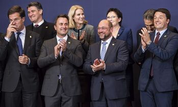 EU heads of state pose for a group photo during an EU summit in Brussels, on Thursday, Oct. 23, 2014. EU leaders gathered Thursday for a two-day summit in which they will discuss Ebola, climate change and the economy. From left, Dutch Prime Minister Mark Rutte, Croatian Prime Minister Zoran Milanovic, Luxembourg's Prime Minister Xavier Bettel, Danish Prime Minister Helle Thorning-Schmidt, European Parliament President Martin Schultz, Polish Prime Minister Ewa Kopacz, Hungarian Prime Minister Viktor Orban and Italian Prime Minister Matteo Renzi. (AP Photo/Geert Vanden Wijngaert)