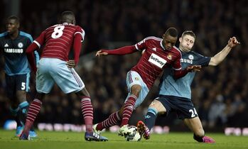 West Ham United's Diafra Sakho, second right, is challenged for the ball by Chelsea's Gary Cahill during the English Premier League soccer match between West Ham United and Chelsea , at the Boleyn ground in London, Wednesday, March, 4, 2015. (AP Photo/Alastair Grant)