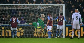 Aston Villa's goalkeeper Brad Guzan is beaten by the free kick of Swansea City's Gylfi Sigurdsson, not pictured, during their English Premier League soccer match at the Liberty Stadium, Swansea, Wales, Friday, Dec. 26, 2014. (AP Photo/Nigel French, PA Wire) UNITED KINGDOM OUT - NO SALES - NO ARCHIVES