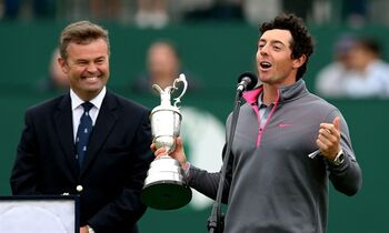 Rory McIlroy of Northern Ireland speaks while holding the Claret Jug trophy after winning the British Open Golf championship at the Royal Liverpool golf club, Hoylake, England, Sunday July 20, 2014. (AP Photo/Scott Heppell)