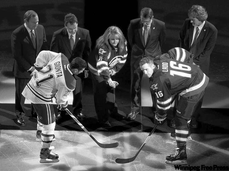 jonathan hayward / the canadian pressRick Rypien�s mother Shelly Crawford drops the puck for the ceremonial faceoff between Jets captain Andrew Ladd and Habs captain Brian Gionta. (CP)