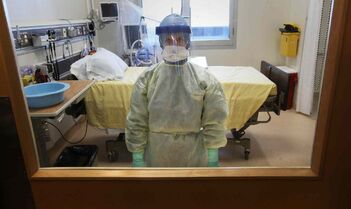 The Health Sciences Centre has prepared 10 isolation rooms which could be used to treat patients suspected of being infected with the Ebola virus. Nurse Lori Fleetwood displays the personal protective equipment health-care workers would use.