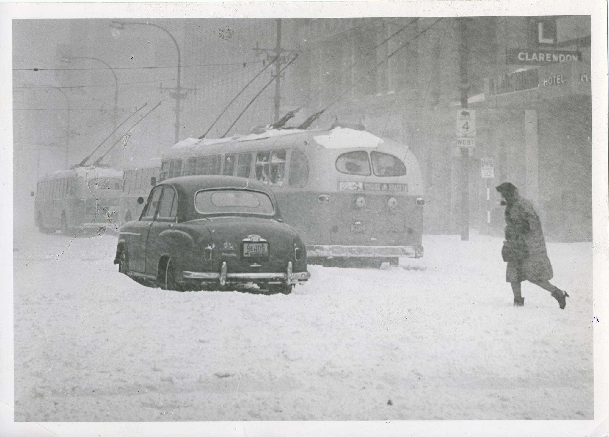 Jack Ablett/Winnipeg Free Press Archives Winnipeg Blizzard (8) March 5, 1966 A car sits trapped right In the middle of Portage Avenue. fparchive</p></p>