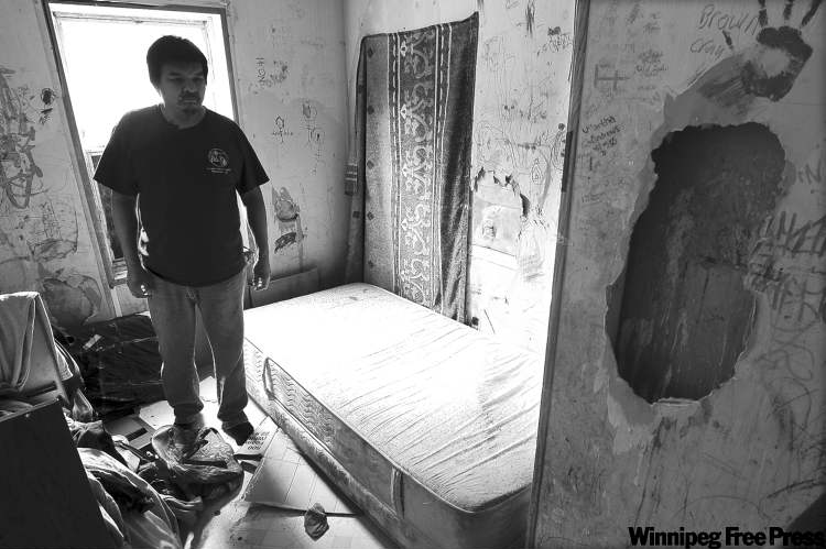 Richard Andrews in a bedroom in his decrepit trailer. Many residents of the reserve have to get by on 15 litres of treated water a day.