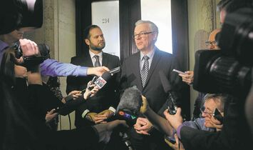 At right, Premier Greg Selinger and Matt Wiebe, the NDP Party Caucus Chair speak to media outside the caucus room Thursday afternoon. Bruce Owen/ Larry Kusch Stories Wayne Glowacki / Winnipeg Free Press Nov.13 2014