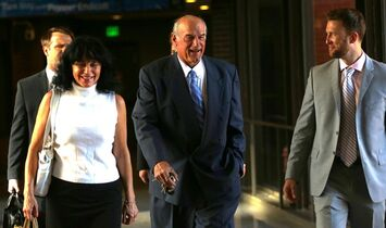 FILE - In this July 22, 2014 file photo former Minnesota Gov. Jesse Ventura, center, arrives at court with his wife, Terry, and others for his defamation lawsuit against