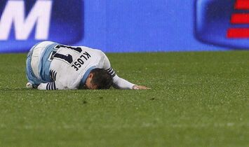 Lazio's Miroslav Klose lies ont he pitch after being injured during an Italian Cup semifinal first leg soccer match between Lazio and Napoli, at Rome's Olympic stadium, Wednesday, March 4, 2015. (AP Photo/Riccardo De Luca)