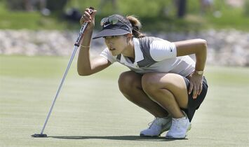 Michelle Wie checks her putt line before putting on the 15th hole during the second round of the LPGA North Texas Shootout golf tournament, Friday, May 1, 2015, in Irving, Texas. (AP Photo/LM Otero)