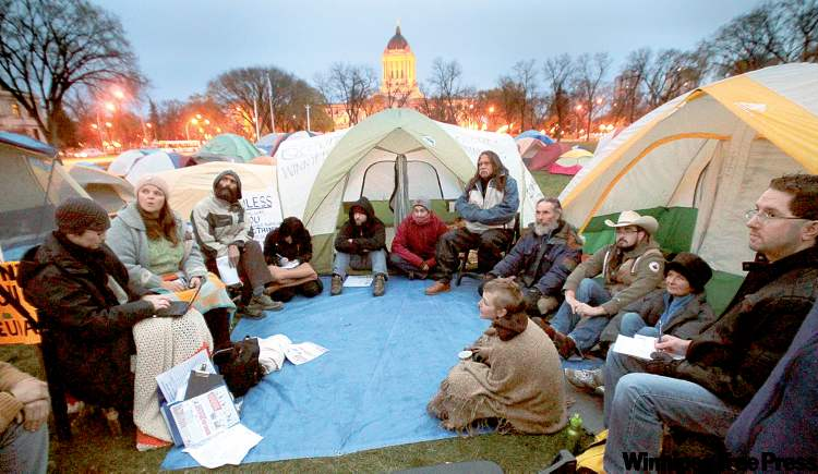 One of the many committees associated with Occupy Winnipeg meets at their camp in Memorial Park across from the Manitoba legislature. The protesters say they're planning for a lengthy occupation.