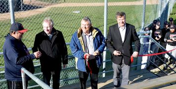 From left to right: From left to right: Elmwood Giants past president Al Kinley, former city councillor Thomas Steen, Elmwood MLA Jim Maloway, and MP Lawrence Toet cut the red ribbon at the Elmwood Giants Opening Ceremonies on Oct. 11.