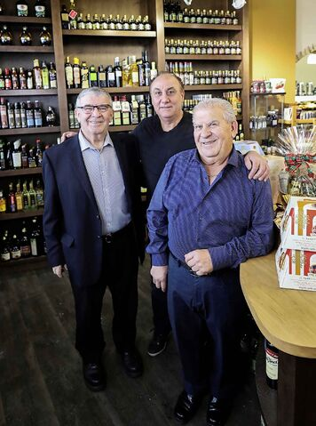 Tony DeLuca (left) and Pasquale DeLuca (right) with long-time employee John Colatruglio.