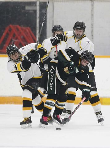 The North Winnipeg Satellites (in white) play the St. Malo Warriors at Billy Mosienko Arena, Tuesday.