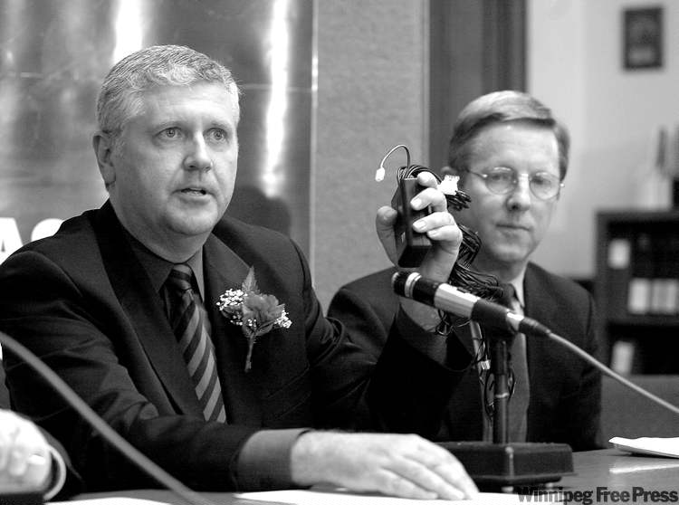 University of Manitoba criminologist Rick Linden (right) watches as Attorney General Gord Mackintosh shows an immobilizer anti-theft device in April 2003.