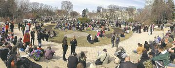 Hundreds of people gathered Sunday at the Manitoba legislature to enjoy some pot.