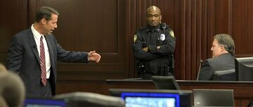 Prosecutor John Guy, left, cross examines Michael Dunn, right, during Dunn's retrial at the Duval County Courthouse, Tuesday, Sept. 30, 2014, in Jacksonville, Fla. Dunn is being retried on murder charges for the shooting death of 17-year old Jordan Davis in a dispute over loud music at a Jacksonville gas station in November of 2012. Dunn was found guilty of three counts of attempted murder and one count of shooting or throwing a deadly missile during his previous trial, but the jury was deadlocked on the murder charge. (AP Photo/The Florida Times-Union, Bruce Lipsky, Pool)