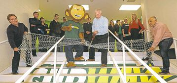 In the picture at right, Peter Muir (far left), chair of the Winnipeg Soccer Federation, holds a goal net. Cutting the net with Subway's mascot is Paul Karam, Subway franchise owner and local board chair, while Craig Kitching (far right), Subway franchise owner and local board member, also holds the net.