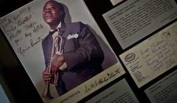 A Louis Armstrong post card, Armstrong himself sent to his friend, photographer Jack Bradley, is part of a new exhibition at the Louis Armstrong House Museum, Friday Oct. 17, 2014 in New York. The postcard is part of the collection from photographer Jack Bradley, whose close friendship with Armstrong gave him unrestricted access to make thousands of photographs of the great jazz musician. A portion of his collection, including sound recordings and fan memorabilia, is featured in a new exhibition opening Tuesday at the Louis Armstrong House Museum in Corona, Queens. (AP Photo/Bebeto Matthews)