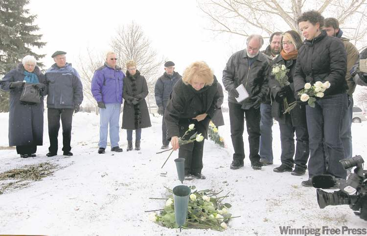 Wilma Derksen places roses on her daughter's grave following the conviction of Candace's killer last February.