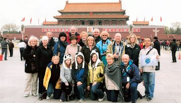 This undated photo provided by Friendly Planet Travel shows participants in one of the company's group tours posing in Tiananmen Square in Beijing. There are many things to consider when choosing a group tour, including type of accommodations, activities, and price. Many tours charge extra for solo travelers because they will be the sole occupants of hotel rooms that ordinarily accommodate two people, but Friendly Planet offers a service to help solo travelers find compatible roommates and avoid the single supplement charge. (AP Photo/Friendly Planet)