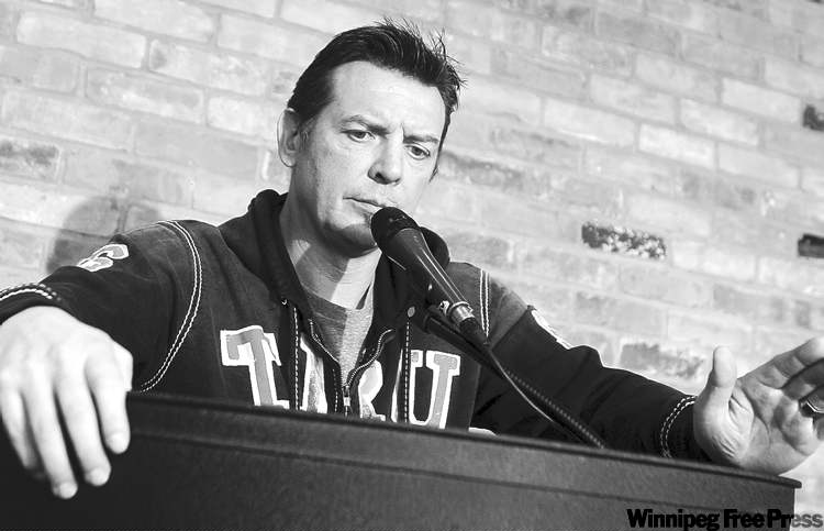 Theoren Fleury speaks to the media Wednesday in Calgary at a news conference about Graham James' guilty plea.