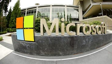 The Microsoft Corp. signage outside the Microsoft Visitor Center in Redmond, Wash. is pictured July 3, 2014. THE CANADIAN PRESS/AP, Ted S. Warren