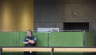A Montreal Courthouse special constable stands next to screens to shield the potential jurors during jury selection in the Luka Magnotta trial in Montreal, on September 8, 2014. THE CANADIAN PRESS/Graham Hughes