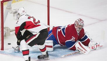 Ottawa Senators' Erik Condra (22) scores on Montreal Canadiens goaltender Carey Price during third period of Game 5 NHL first round playoff hockey action in Montreal, Friday, April 24, 2015. THE CANADIAN PRESS/Graham Hughes