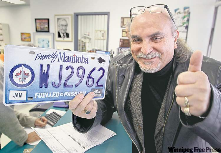 Sal Garofoli was one of the first customers to pick up his Jets plate at his Autopac agent's office.