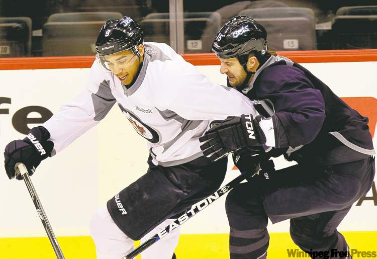wayne glowacki / winnipeg free pressWinnipeg Jets left-winger Tanner Glass (right) has his work cut out keeping pace with speedy Evander Kane during scrimmage on Monday.