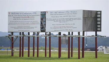 "This photo taken on Sunday, Aug. 17, 2014, and provided by Robert A. Franco, shows a billboard in Coshocton, Ohio opposing deep-injection wells . Michael Boals, an Ohio man who uses a biblical reference and a statement against ""poisoned waters"" on billboards opposing local deep-injection gas wells is fighting a legal threat from the Texas well owner on grounds he's exercising his free speech. (AP Photo/Robert A. Franco)"