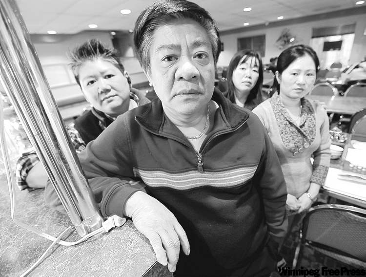 Bac Bui (centre), owner of Vi-Ann, with his staff (from left) Leslie Tu, Trink Diep, and Thao Dang, says he realized a dream when he bought the Osborne Village restaurant in 2001 after working at a factory for 25 years.