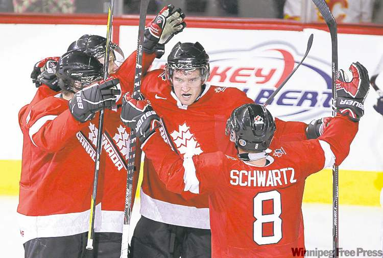 Team Canada forward Mark Stone (second right) celebrates his  exhibition game goal against Finland last week in Calgary.