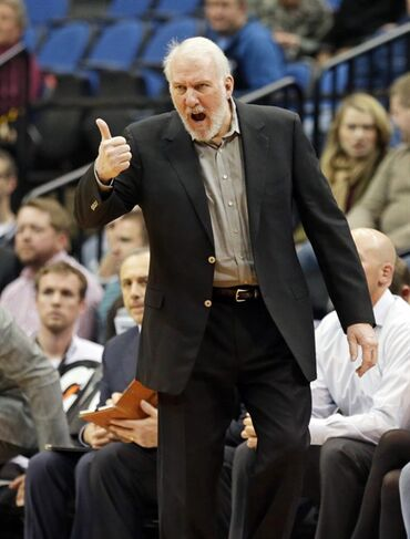 San Antonio Spurs head coach Gregg Popovich yells instructions in the second half of an NBA basketball game against the Minnesota Timberwolves, Friday, Nov. 21, 2014, in Minneapolis. The Spurs won 121-92. (AP Photo/Jim Mone)